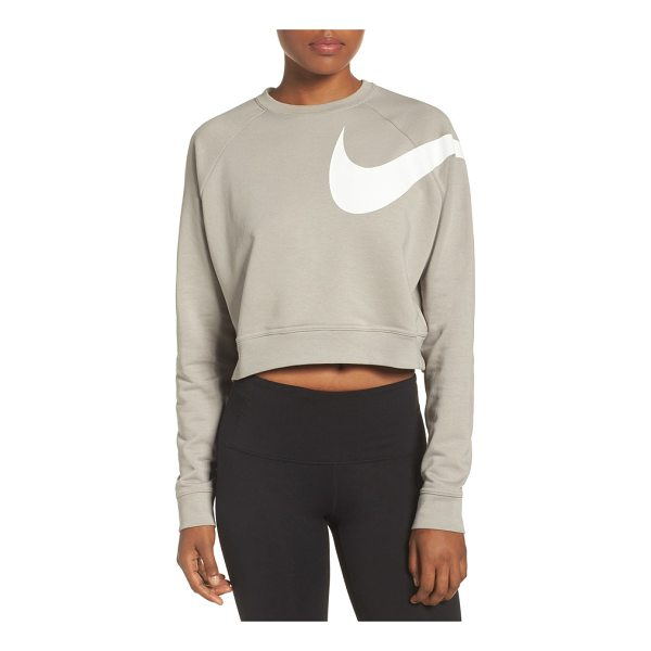 NIKE dry versa training crop top - A sweat-wicking top in a cropped silhouette offers...