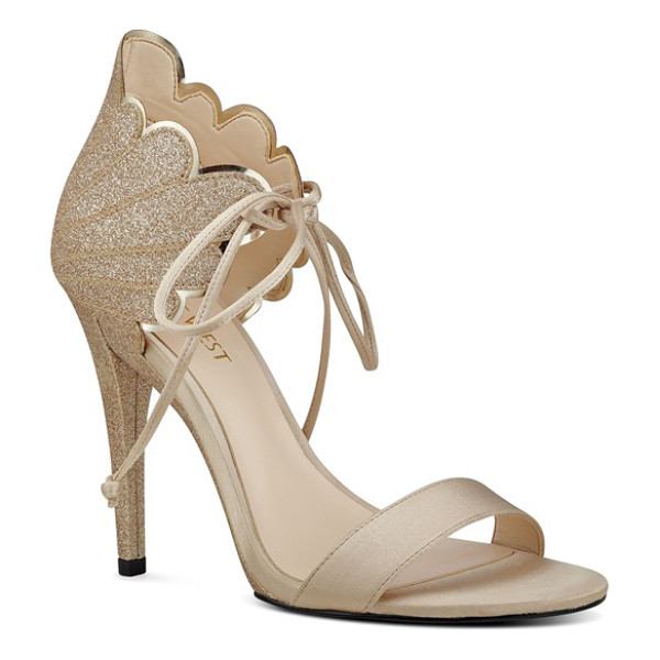 NINE WEST 'carly' ankle tie sandal - A wing-like counter characterized by high-shine scalloped...