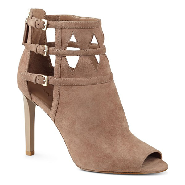 NINE WEST 'laulani' cutout peep toe bootie - A trio of buckled straps overlap the intricate cutouts that...