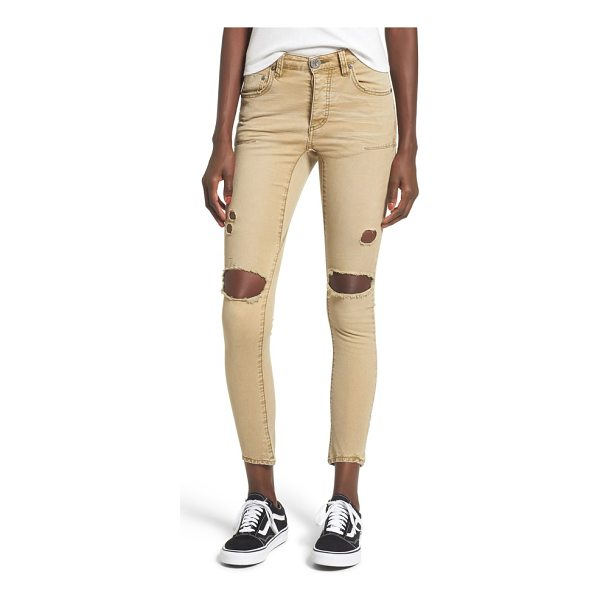 ONE TEASPOON freebirds ripped low waist skinny jeans - Busted knees and a yellowed wash add to the punk-rock...
