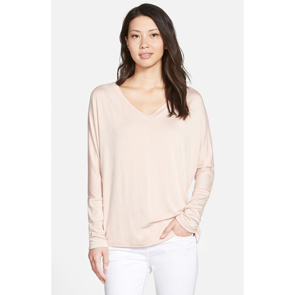 PLEIONE v-neck top with woven back panel - A knit pullover with slouchy dropped-shoulder styling gets...
