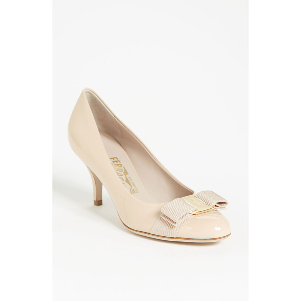SALVATORE FERRAGAMO carla pump - A signature grosgrain bow accents a shiny patent leather