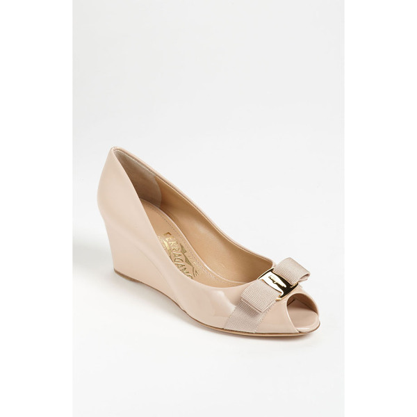 SALVATORE FERRAGAMO sissi pump - A trim, logo-etched bow perfects the prim of a polished...