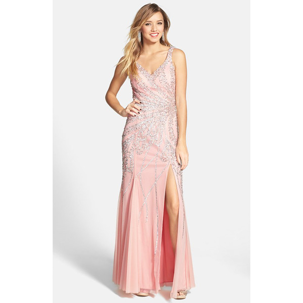 SEAN COLLECTION beaded gown - Beams of beads call attention to the waist of a...