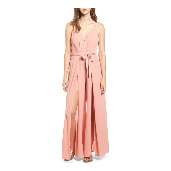 SOCIALITE split leg jumpsuit - Dramatic slits from hip to hem create breezy movement in...