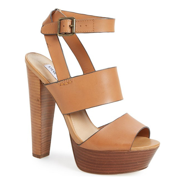 STEVE MADDEN dezzzy leather ankle strap sandal - A soaring stacked heel and super-chunky platform add...