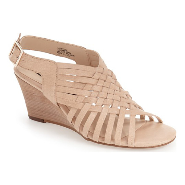 STEVEN BY STEVE MADDEN livvey wedge sandal - Interwoven leather straps extend the casual sophistication...