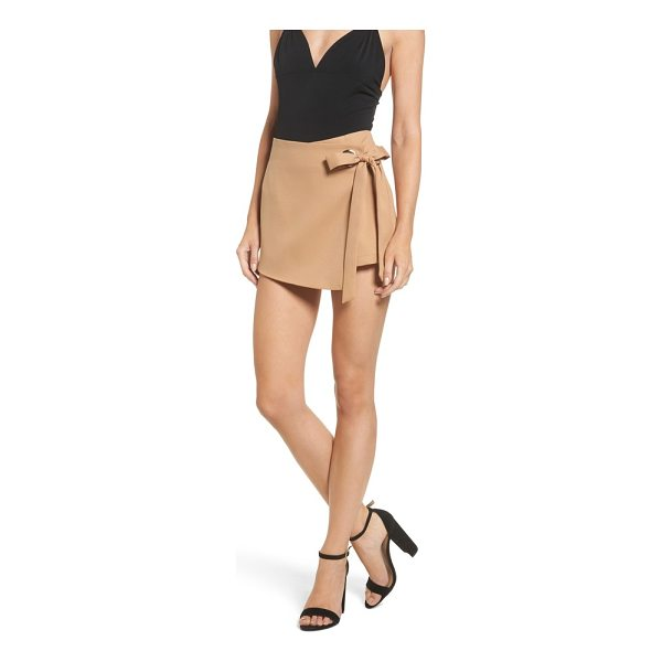 STOREE grommet mini skort - An oversized tie and grommet hardware secure the wrap-front...