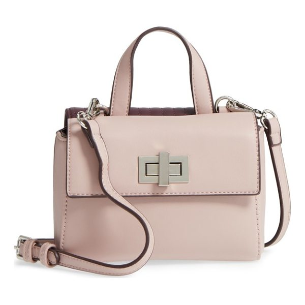 STREET LEVEL two-sided mini crossbody bag - Two-faced becomes a compliment with a faux leather bag...