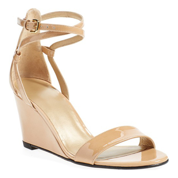 STUART WEITZMAN backdraft ankle strap wedge sandal - Glossy patent leather styles a sleek, wear-with-anything...