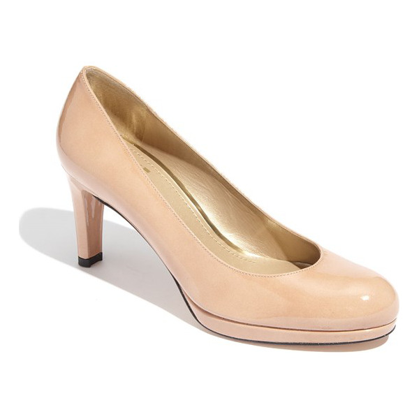STUART WEITZMAN blog platform pump - A classic pump with an almond-shaped toe is elevated by a...
