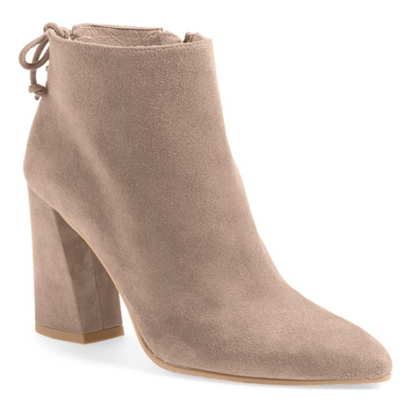 STUART WEITZMAN grandiose pointy toe boot - A flirty tie back and angular block heel accent a standout...