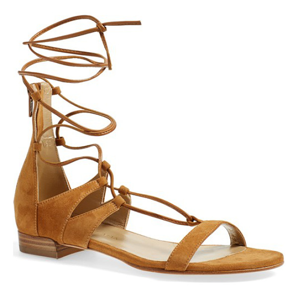 STUART WEITZMAN tie-up sandal - A chic gladiator-inspired flat sandal is shaped from...
