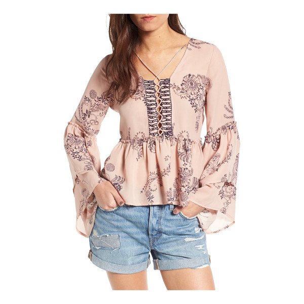 SUN & SHADOW tiered sleeve lace-up top - A delicate floral-paisley print swirls across a graceful...