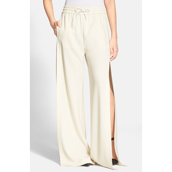 T BY ALEXANDER WANG side slit wide leg track pants - Sportswear and luxe street style combine on these wide-leg...
