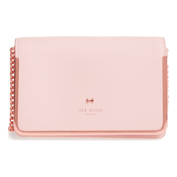 TED BAKER highbox leather convertible clutch - Golden hardware frames the flap of a sophisticated,...