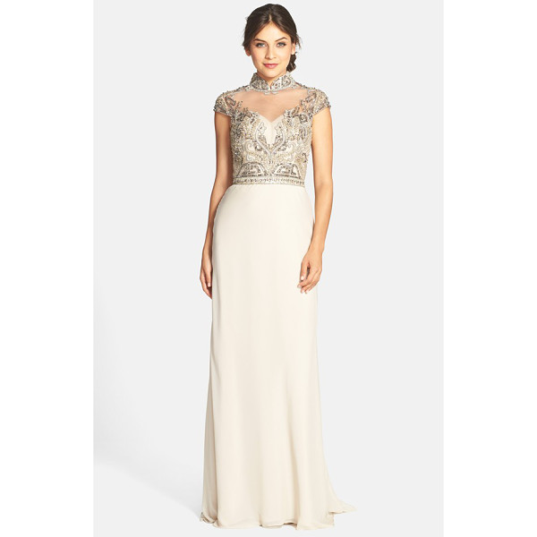 TERANI COUTURE embellished high neck gown - Cap sleeves frame the elegant high neckline of a...