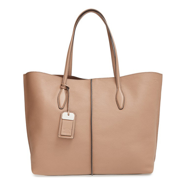 TOD'S Rest - A pebbled leather shopper with minimalist styling is...