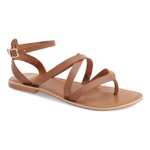 TOPSHOP hercules strappy leather thong sandal - A flat leather thong sandal is styled with crisscrossing...