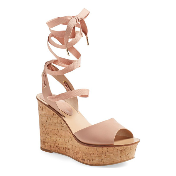 TOPSHOP wise platform wedge sandal - A lofty cork wedge amplifies the retro swagger of an...