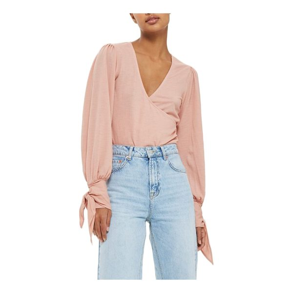 TOPSHOP wrap front tie sleeve top - Billowy long sleeves wrapped with flouncy ties at the cuffs...