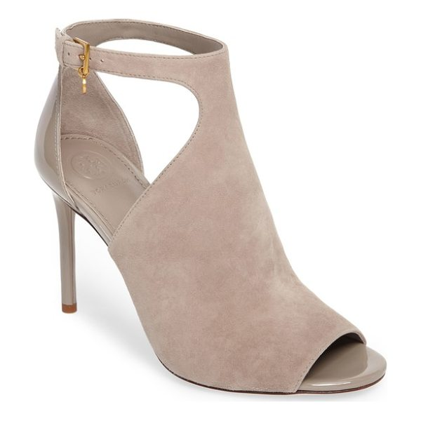 TORY BURCH ashton open toe bootie - A logo charm dangles from the ankle along the bold cutouts...