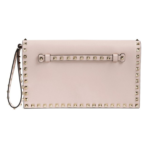 VALENTINO Rockstud calfskin leather clutch - Signature pyramid studs trace the clean, modern profile of...
