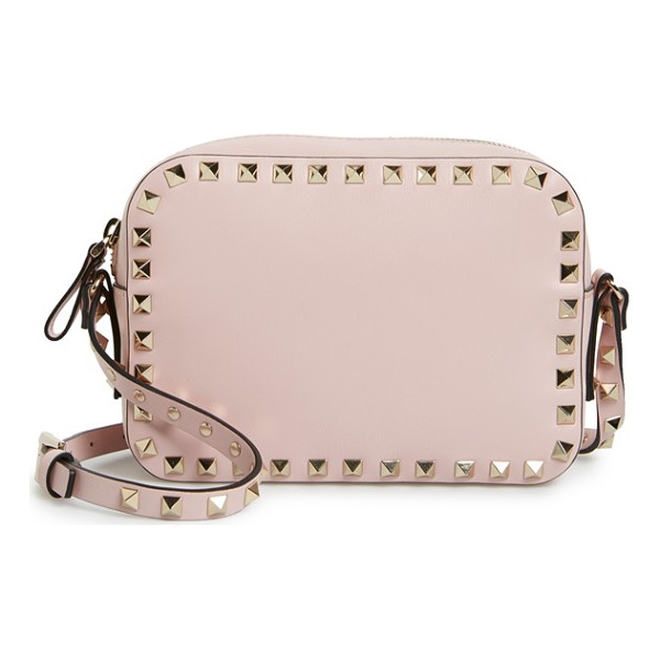 VALENTINO Rockstud camera crossbody bag - Iconic rockstuds outline a supple leather camera bag for a...