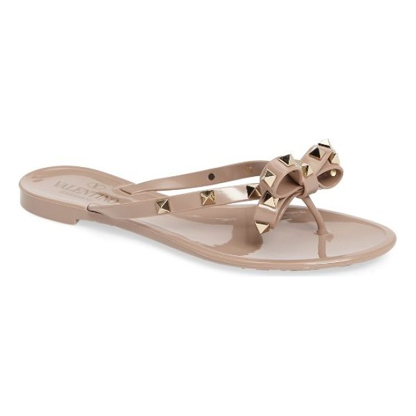 VALENTINO 'rockstud' flip flop - Golden pyramid studs punctuate a bow-topped flip-flop for a...