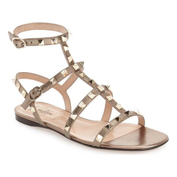 VALENTINO 'rockstud' gladiator sandal - Golden pyramid studs punctuate the Italian leather straps...