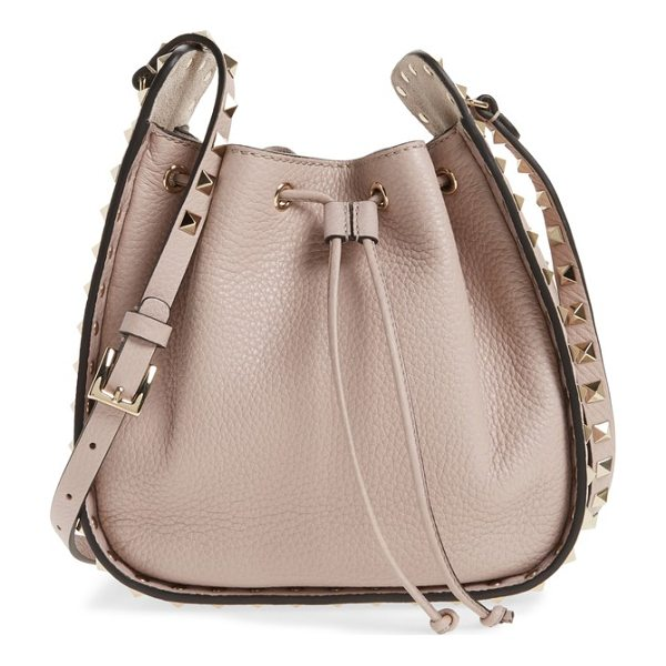 VALENTINO rockstud leather bucket bag - Polished rockstuds frame the sides and spike the strap of a...