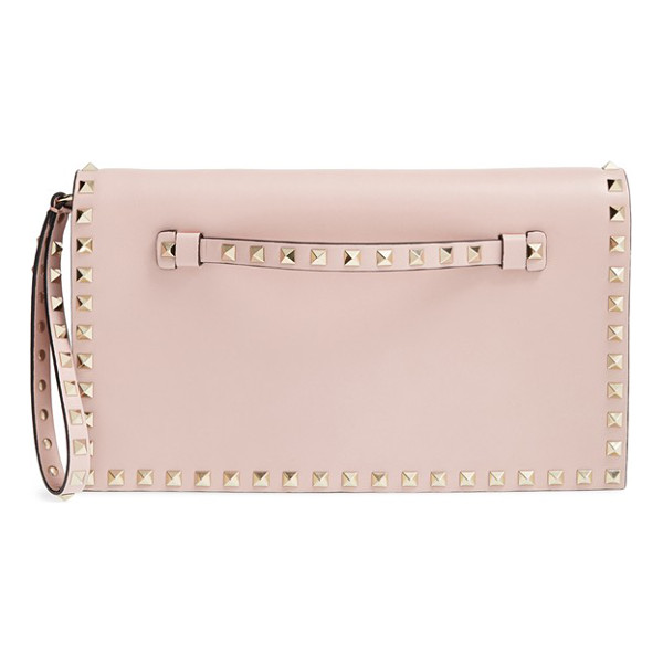 VALENTINO Rockstud leather clutch - Iconic pyramid studs toughen up a pastel-hued flap clutch...