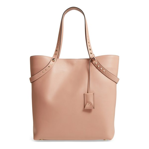 VALENTINO rockstud leather tote - Straps accented with graduated pyramid studs drape across a...