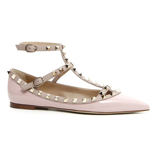 VALENTINO 'rockstud' t-strap flat - Signature pyramid studs trace the topline and caged straps...