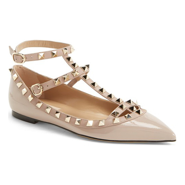 VALENTINO rockstud t-strap flat - Signature pyramid studs trace the topline and caged straps...