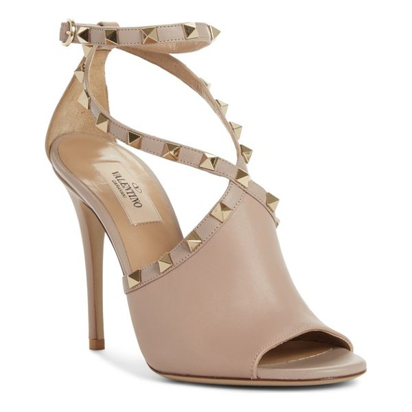 VALENTINO rockstud peep toe sandal - A mule-inspired detail at the vamp stops short at the...
