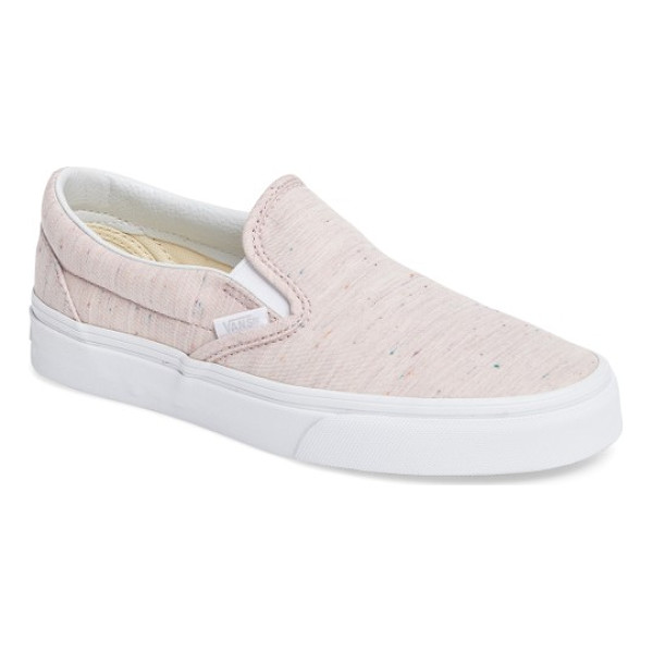 VANS classic slip-on sneaker - A must-have for your weekend wardrobe. This iconic skate...