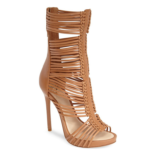 VINCE CAMUTO barbara strappy caged leather sandal - Slender leather straps weave through a centerpiece set off...