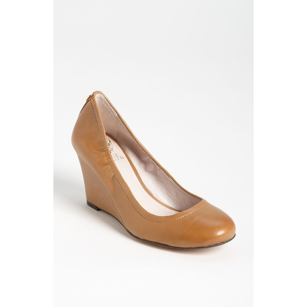 VINCE CAMUTO elmay pump - Polished leather comprises a wrapped-wedge pump,...