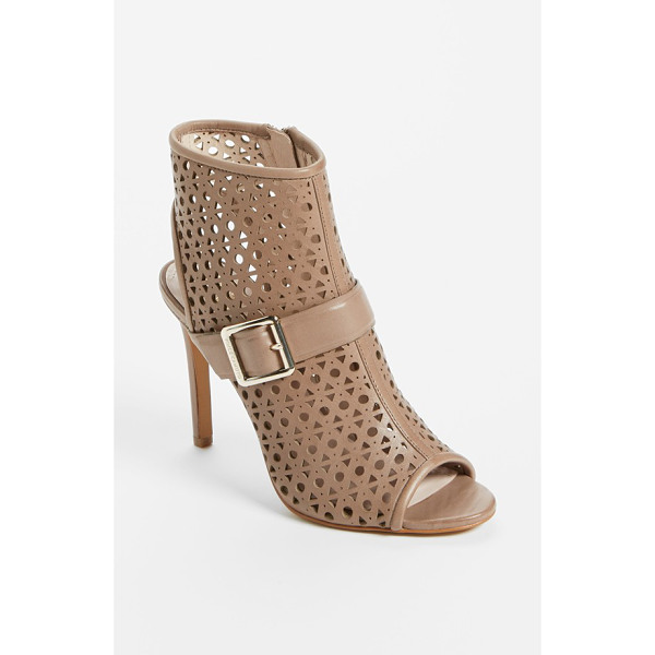 VINCE CAMUTO 'kaleen' leather bootie - Geometric perforations punctuate a contemporary peep-toe...