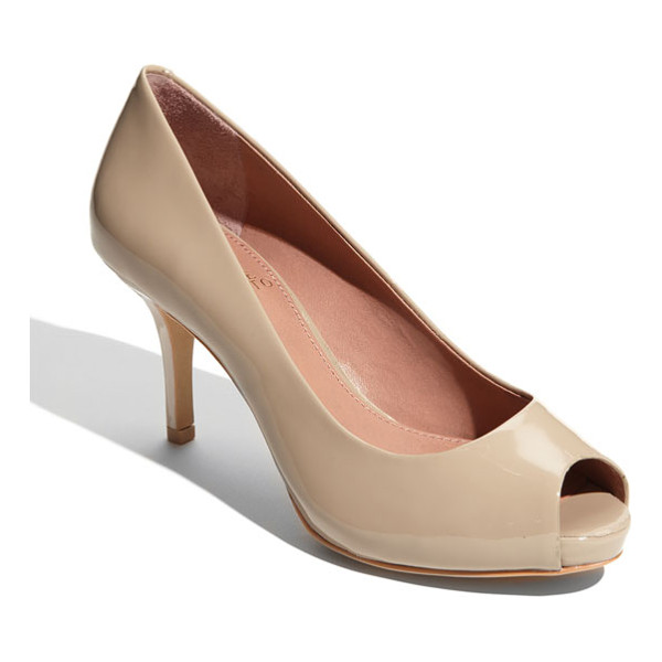 VINCE CAMUTO kira pump - A slender wrapped heel grounds a glossy leather pump styled...
