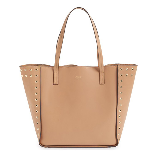VINCE CAMUTO Punky leather tote - Eye-catching rivets outline the side panels of a sleek...