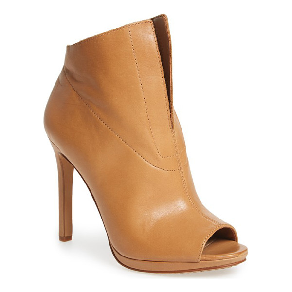 VINCE CAMUTO rora peep bootie - A deep-V topline underscores the modern refinement of a...