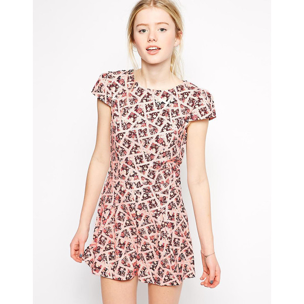 GIRLS ON FILM Romper in geo floral print - Romper by Girls On Film Printed woven fabric Boat neckline...