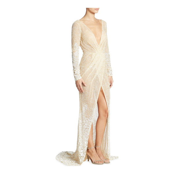 BERTA long-sleeve beaded gown - A plunging V-neckline details this radiant beaded gown....