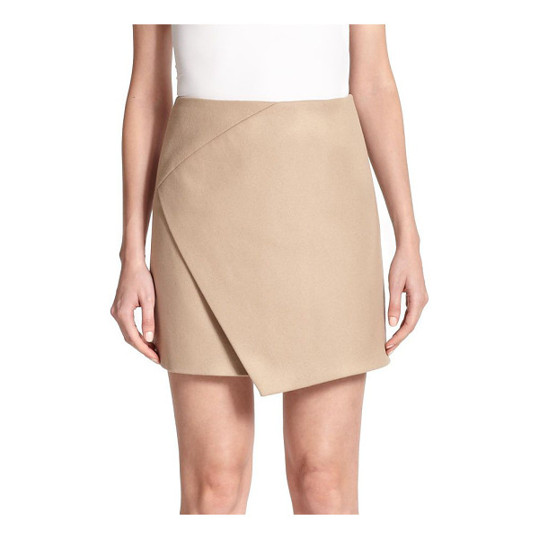 CARVEN Faux wrap skirt - This chic skirt fits tailored through the hips, then cuts...