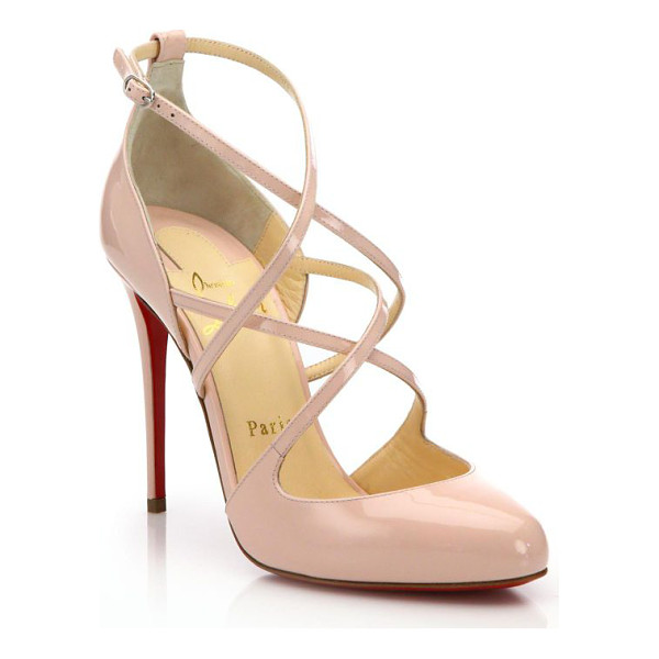 CHRISTIAN LOUBOUTIN Patent leather strappy pumps - Lustrous patent pump with charming strap detail. Covered...