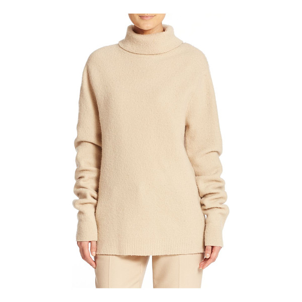 DKNY Turtleneck pullover sweater - This cold-weather classic is updated with a roomy, relaxed...