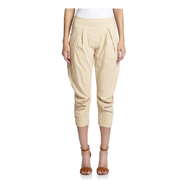DONNA KARAN Pleated-front pants - Exquisitely tailored in Italy, this cropped silhouette...
