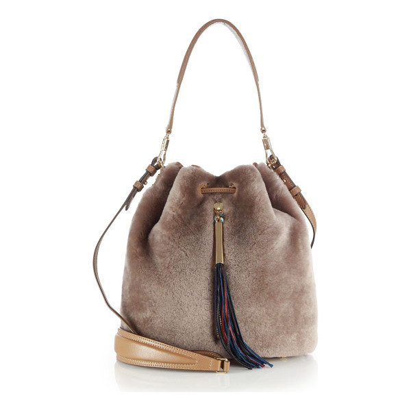 ELIZABETH AND JAMES Cynnie shearling bucket bag - Crafted of plush shearling and trimmed with leather, this...